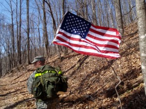 Soldier carrying American Flag at Terrapin Mtn 50k